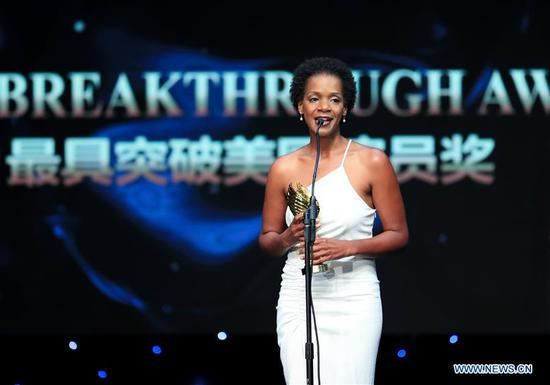 Actress Kelsey Scott who won the Most Influential Award, receives the trophy during the awarding ceremony of the 14th Chinese American Film Festival (CAFF) in Los Angeles, the United States, Oct. 30, 2018. The 14th Chinese American Film Festival (CAFF) kicked off Tuesday at the Ricardo Montalban Theater in Hollywood in the U.S. city of Los Angeles. (Xinhua/Li Ying)