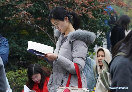 Candidates review before taking the national civil servant exam at Nanjing Forestry University in Nanjing, capital of east China's Jiangsu Province, Dec. 2, 2018. The written exam of the national civil servant exam was held on Sunday across the country. (Xinhua/Sun Can)
