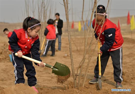 Children plant trees at Wuzhong Village in Qiaoxi District of Xingtai City, north China's Hebei Province, March 11, 2019. Students from Guoshoujing Primary School took part in a tree-planting activity to greet the upcoming Tree Planting Day, also known as Arbor Day, which falls on March 12 each year. (Xinhua/Mu Yu)