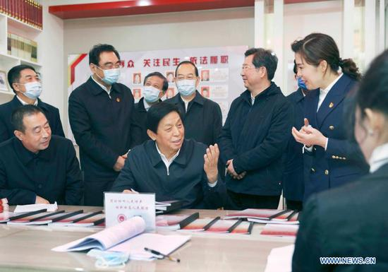 Li Zhanshu, a member of the Standing Committee of the Political Bureau of the Communist Party of China Central Committee and chairman of the Standing Committee of the National People's Congress, inspects a local legislators' liaison station in Taiyuan, north China's Shanxi Province, Nov. 18, 2020. Li made an inspection tour in Shanxi from Monday to Wednesday. (Xinhua/Liu Weibing)