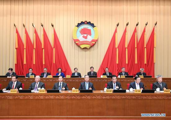 Wang Yang, a member of the Standing Committee of the Political Bureau of the Communist Party of China Central Committee and chairman of the Chinese People's Political Consultative Conference (CPPCC) National Committee, attends the opening meeting of the 15th session of the Standing Committee of the 13th CPPCC National Committee in Beijing, capital of China, March 1, 2021. (Xinhua/Shen Hong)