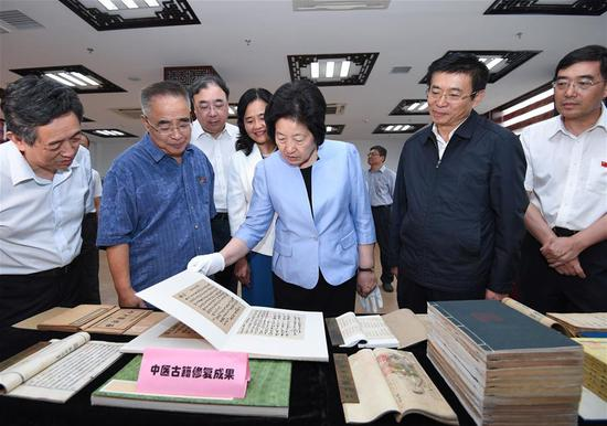 Chinese Vice Premier Sun Chunlan, also a member of the Political Bureau of the Communist Party of China (CPC) Central Committee, learns about the preservation and utilization of traditional Chinese medicine (TCM) classics at the China Academy of Chinese Medical Sciences in Beijing, capital of China, Aug. 24, 2018. Sun made an inspection tour of the National Administration of Traditional Chinese Medicine and the China Academy of Chinese Medical Sciences on Friday. (Xinhua/Shen Hong)