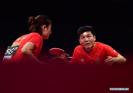 Fan Zhendong (R)/Ding Ning of China compete against Muhamad Ashraf Haiqal/Ying Ho of Malaysia during the mixed doubles preliminary second round match at 2019 ITTF World Table Tennis Championships in Budapest, Hungary, April 21, 2019. Fan Zhendong/Ding Ning won 3-0. (Xinhua/Lu Yang)