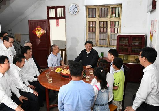 Chinese President Xi Jinping, also general secretary of the Communist Party of China Central Committee and chairman of the Central Military Commission, visits Tantou Village in Yudu County, Ganzhou City, during an inspection tour of east China's Jiangxi Province on May 20, 2019. At the home of veteran Sun Guanfa, a descendant of a Red Army martyr, Xi chatted with Sun's family and local officials, and learned in detail about the production developments and life improvements of people in the old revolutionary base. (Xinhua/Xie Huanchi)