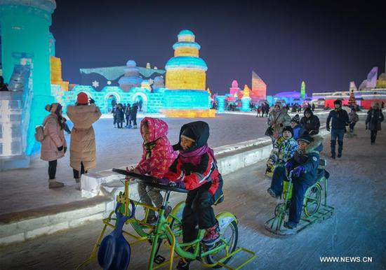 Children have fun on the 36th Harbin Ice and Snow Festival at Harbin Ice-Snow World in Harbin, capital of China's northernmost Heilongjiang Province, Jan. 5, 2020. The annual Harbin Ice and Snow Festival opened to public here on Sunday. (Xinhua/Wang Song)