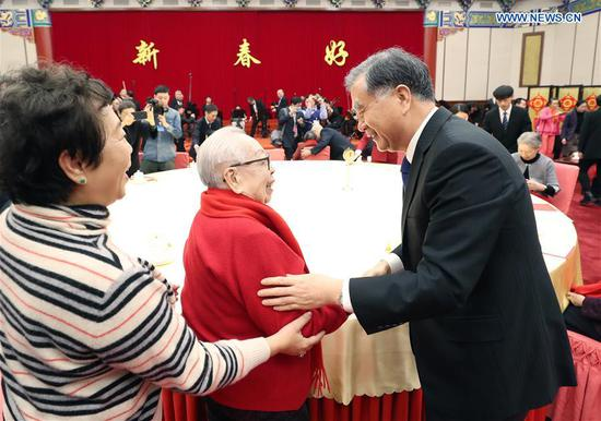 Wang Yang, a member of the Standing Committee of the Political Bureau of the Communist Party of China (CPC) Central Committee and chairman of the National Committee of the Chinese People's Political Consultative Conference (CPPCC), attends a Spring Festival reception for widows of late luminaries in Beijing, capital of China, Jan. 15, 2020. (Xinhua/Yao Dawei)