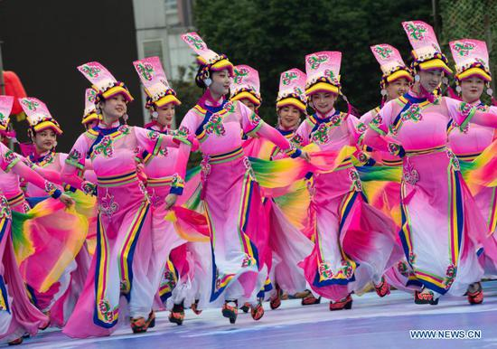 Students of Qiang ethnic group perform dance at a square in Beichuan Qiang Autonomous County, southwest China's Sichuan Province, Nov. 14, 2020. A series of activities in celebration of the new year of the Qiang ethnic group kicked off in Beichuan on Saturday. (Xinhua/Jiang Hongjing)