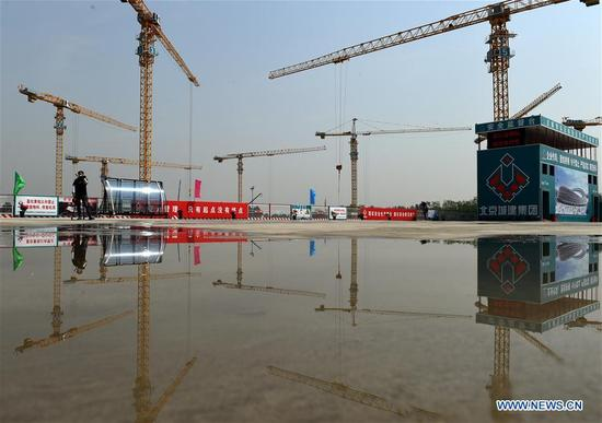 The National Speed Skating Oval is under construction in Beijing, capital of China, May 9, 2018. The National Speed Skating Oval, which will host speedskating competitions during the 2022 Beijing Winter Olympic and Paralympic Games, is expected to be completed by the end of 2019. (Xinhua/Luo Xiaoguang)