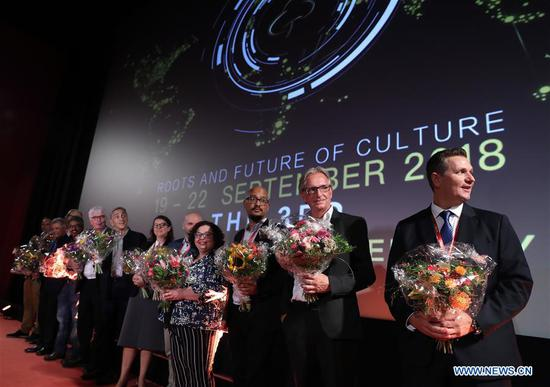 Jury members attend the opening ceremony of the third Golden Tree International Documentary Film Festival in Frankfurt, Germany, Sept. 19, 2018. (Xinhua/Luo Huanhuan)