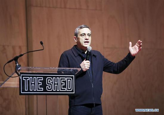 Artistic Director and CEO of The Shed Alex Poots addresses a media preview in The Shed, a new arts center in New York, the United States, on April 3, 2019. The Shed, New York City's new arts center that commissions, develops, and presents original works of art, across all disciplines, for all audiences, will open to the public on April 5 with the world premiere of Soundtrack of America. (Xinhua/Wang Ying)