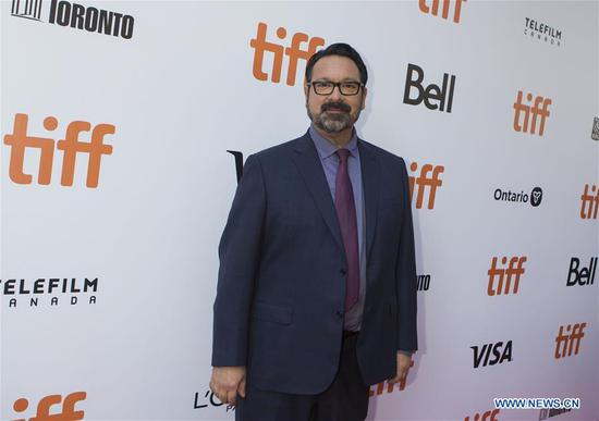 Director James Mangold poses for photos before the international premiere of the film