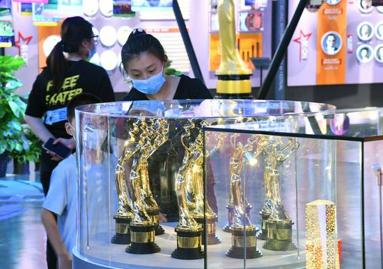 People visit the Beijing International Film Festival (2011-2020) Achievements Retrospective exhibition at China National Film Museum in Beijing, capital of China, Aug. 23, 2020. (Xinhua/Ren Chao)