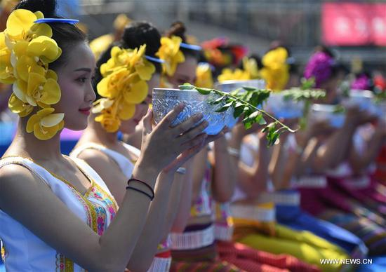 A ceremony is held to celebrate the water-sprinkling festival at a square in Jinghong City, Dai Autonomous Prefecture of Xishuangbanna, southwest China's Yunnan Province, April 15, 2018. People sprinkle water to each other to pray for good fortune during the traditional water-sprinkling festival, which is also the New Year festival of the Dai ethnic group. (Xinhua/Wang Changshan)