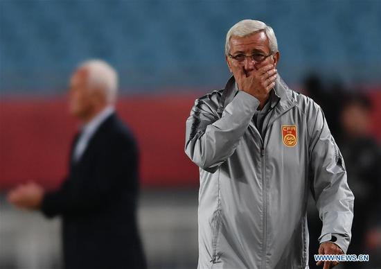 Marcello Lippi, head coach of China reacts during the CFA Team China International Football Match 2018 between China and Syria in Nanjing, capital of east China's Jiangsu Province, Oct. 16, 2018. China won 2-0. (Xinhua/Ji Chunpeng)