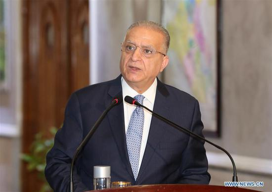 Iraqi Foreign Minister Mohammed al-Hakim speaks at a joint press conference in Baghdad, Iraq, on Aug. 4, 2019. Foreign ministers of Iraq, Egypt and Jordan held a meeting on Sunday in Baghdad aimed at boosting Arab relations and seeking to ease tension in the Middle East region. (Xinhua/Khalil Dawood)