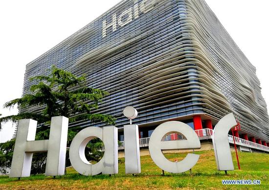 Photo taken on May 11, 2018 shows the office building of the board of directors of Haier Group Corporation, China's consumer electronics and home appliances giant, in Qingdao, a coastal city in east China's Shandong Province. Home to Tsingtao Beer and home appliance giant Haier, Qingdao is becoming a more attractive place to run important multilateral events. In June, the coastal city will host the 18th summit of the Shanghai Cooperation Organization (SCO). (Xinhua/Li Ziheng)