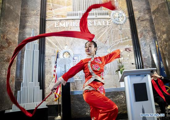 A dancer performs during the lighting ceremony for Chinese Spring Festival at the Empire State Building in Manhattan, New York, the United States, on Feb. 1, 2019. The top of the landmark Empire State Building in Manhattan will shine in red, blue and yellow on the nights of next Monday and Tuesday to celebrate the Chinese New Year, which falls on Feb. 5 this year. (Xinhua/Wang Ying)
