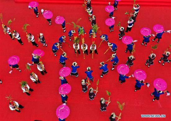 Aerial photo shows people celebrating the Longji Terrace Culture Festival in Longsheng County, south China's Guangxi Zhuang Autonomous Region, June 17, 2019. People of various ethnic groups gathered here to showcase their culture during the festival. (Xinhua/Huang Yongdan)