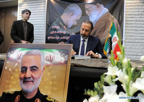 Mansour Azzam, the Minister of Presidential Affairs of Syria, pays tribute to Iranian senior general Qassem Soleimani at the Iranian embassy in Damascus, Syria, on Jan. 5, 2020. The Iranian embassy in Damascus on Sunday organized a ceremony to honor Soleimani. (Photo by Ammar Safarjalani/Xinhua)