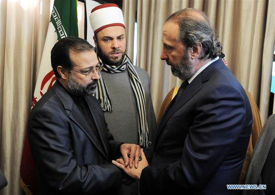 The Charge d'Affaires of the Iranian embassy in Damascus Ali Reza Ayati (L) shakes hands with Mansour Azzam, the Minister of Presidential Affairs of Syria (R), at the Iranian embassy in Damascus, Syria, on Jan. 5, 2020. The Iranian embassy in Damascus on Sunday organized a ceremony to honor senior general Qassem Soleimani. (Photo by Ammar Safarjalani/Xinhua)