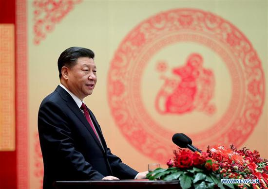 Chinese President Xi Jinping, also general secretary of the Communist Party of China (CPC) Central Committee and chairman of the Central Military Commission, addresses a Chinese Lunar New Year reception at the Great Hall of the People in Beijing, capital of China, Jan. 23, 2020. The CPC Central Committee and the State Council held the reception on Thursday in Beijing. (Xinhua/Ju Peng)