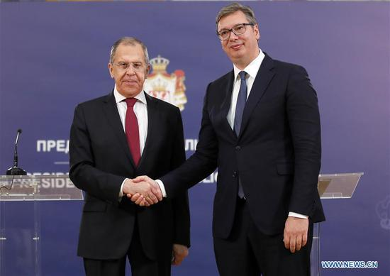 Serbian President Aleksandar Vucic (R) shakes hands with Russian Foreign Minister Sergey Lavrov at a press conference in Belgrade, Serbia, on June 18, 2020. Russia will continue to support Serbia on the issue of the Kosovo and Metohija province, Russian Foreign Minister Sergey Lavrov said during his visit to Serbia on Thursday, stressing the responsibility of the European Union (EU) as a mediator in the ongoing dialogue. (Photo by Predrag Milosavljevic/Xinhua)