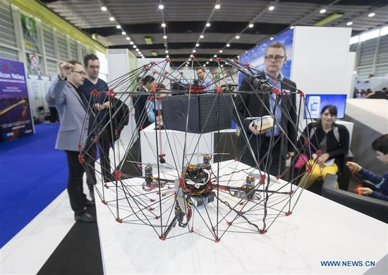 Visitors view a collision-tolerant drone at the 46th International Exhibition of Inventions of Geneva, in Geneva, Switzerland, April 11, 2018. The 46th International Exhibition of Inventions of Geneva kicked off on Wednesday. About 1,000 inventions from 40 countries and regions are displayed during the 5-day exhibition. (Xinhua/Xu Jinquan)
