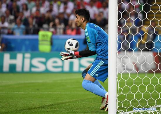 Goalkeeper Alireza Beiranvand of Iran defends during a Group B match between Spain and Iran at the 2018 FIFA World Cup in Kazan, Russia, June 20, 2018. (Xinhua/Chen Cheng)