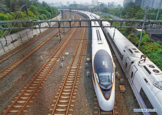 The G7 Fuxing bullet train departs the Beijing South Railway Station in Beijing, capital of China, July 1, 2018. The new longer Fuxing bullet train ran on the Beijing-Shanghai line for the first time on Sunday. With a designed speed of 350 kilometers per hour, the new train measures more than 400 meters in length and has 16 carriages, twice as many as current ones. It can carry nearly 1,200 passengers. (Xinhua/Xing Guangli)