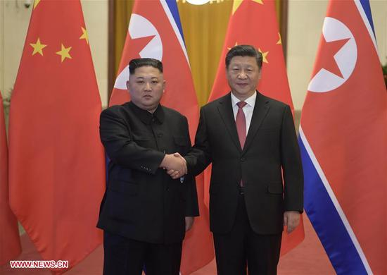 Xi Jinping (R), general secretary of the Central Committee of the Communist Party of China and Chinese president, holds a welcoming ceremony for Kim Jong Un, chairman of the Workers' Party of Korea and chairman of the State Affairs Commission of the Democratic People's Republic of Korea, before their talks at the Great Hall of the People in Beijing, capital of China, Jan. 8, 2019. Xi Jinping on Tuesday held talks with Kim Jong Un, who arrived in Beijing on the same day for a visit to China. (Xinhua/Li Xueren)