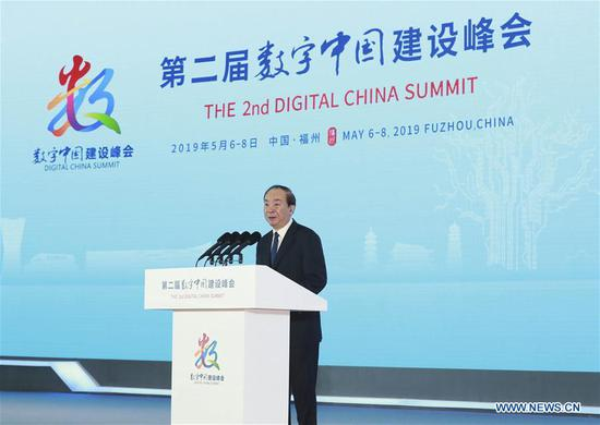 Huang Kunming, a member of the Political Bureau of the Communist Party of China (CPC) Central Committee, also head of the Publicity Department of the CPC Central Committee, speaks at the opening ceremony of the second Digital China Summit in Fuzhou, southeast China's Fujian Province, May 6, 2019. (Xinhua/Ding Lin)