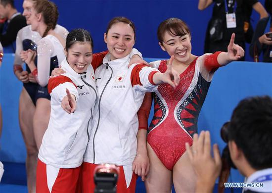 Satake Reina (L), Doihata Chisato (C) and Mori Hakaru of Japan pose for photos after winning the Women's Trampoline Team Final at the 34th FIG Trampoline Gymnastics World Championships in Tokyo, Japan, Nov. 29, 2019. (Xinhua/Du Xiaoyi)