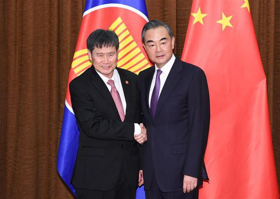 Chinese State Councilor and Foreign Minister Wang Yi (R) meets with ASEAN Secretary General Lim Jock Hoi in Beijing, capital of China, June 12, 2018. (Xinhua/Shen Hong)