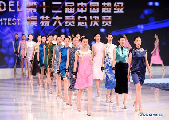 Contestants compete in the evening gown session during the 13th China Super Model Final Contest in Qingdao, east China's Shandong Province, Aug. 26, 2018. (Xinhua/Li Ziheng)
