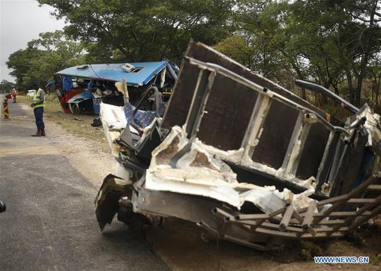 Photo taken on Nov. 8, 2018 shows the scene of a bus accident in Rusape, Manicaland Province, Zimbabwe. Zimbabwean President Emmerson Mnangagwa on Thursday sent a message of condolences following the death of 47 people in a bus accident along the Harare-Mutare highway on Wednesday. (Xinhua/Shaun Jusa)