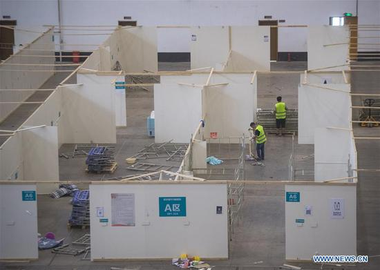 Workers remove hospital facilities at the