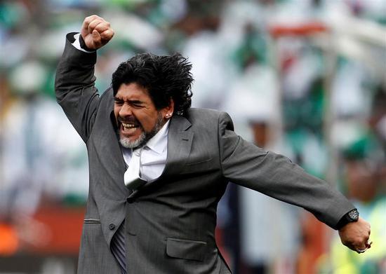 Argentina's coach Diego Maradona celebrates his team's goal against Nigeria during the 2010 World Cup Group B soccer match at Ellis Park stadium in Johannesburg June 12, 2010.