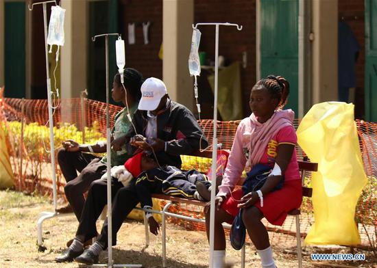 Suspected cholera patients receive treatment at a local hospital in Harare, Zimbabwe, Sept. 11, 2018. Zimbabwe on Tuesday declared the raging cholera outbreak in the capital Harare a state of emergency. The outbreak in the city's high density suburbs of Glen View and Budiriro which began last week has so far killed 20 people and infected more than 2,000 people. (Xinhua/Shaun Jusa)