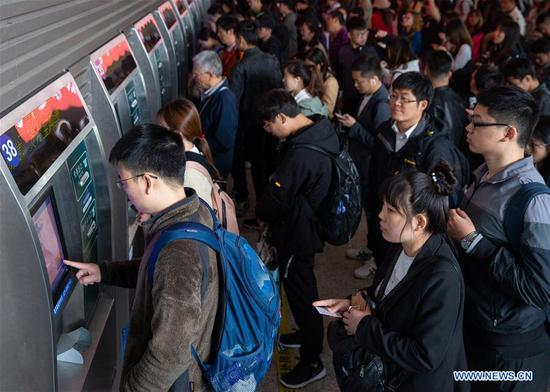 Passengers queue to buy tickets at Nanjing Railway Station in east China's Jiangsu Province, April 30, 2019. Railway stations witness a travel rush as the May Day holiday is on hand. (Xinhua/Su Yang)