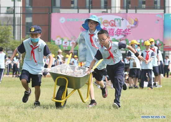 Students play games celebrating the upcoming Children's Day at a primary school in Huzhou City, east China's Zhejiang Province, May 27, 2019. (Xinhua/Xia Pengfei)