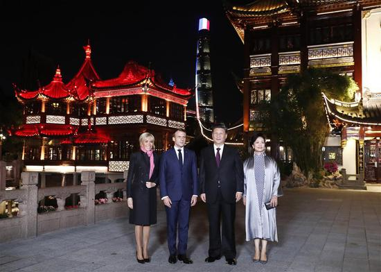 Chinese President Xi Jinping and his wife Peng Liyuan meet with French President Emmanuel Macron and his wife Brigitte Macron at the Yuyuan Garden in Shanghai, east China, Nov. 5, 2019. (Xinhua/Liu Bin)