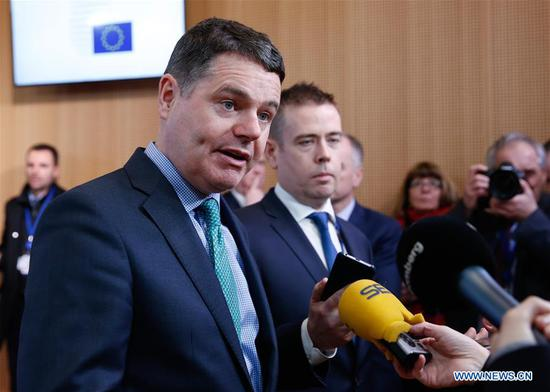 File photo taken on Feb. 19, 2018 shows Irish Finance Minister Paschal Donohoe (Front) speaking to media upon his arrival at a Eurogroup meeting at the EU Council in Brussels, Belgium. Irish Finance Minister Paschal Donohoe has been elected as President of Eurogroup, according to a government statement issued here on July 9, 2020. Donohoe was elected by his fellow euro area finance ministers at a video conference of the Eurogroup held earlier in the day, said the statement. (Xinhua/Ye Pingfan)