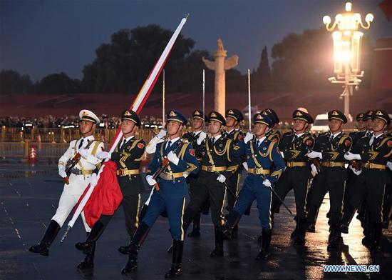 A flag-raising ceremony to celebrate the 71st anniversary of the founding of the People's Republic of China is held at the Tian'anmen Square in Beijing on Oct. 1, 2020. [Photo/Xinhua]