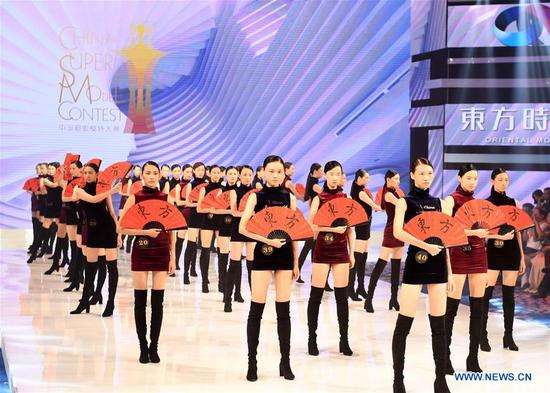 Contestants perform during the 13th China Super Model Final Contest in Qingdao, east China's Shandong Province, Aug. 26, 2018. (Xinhua/Li Ziheng)