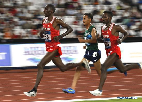 Birhanu Balew (R) of Bahrain competes during men's 5000m final of athletics at the 18th Asian Games in Jakarta, Indonesia on Aug. 30, 2018. (Xinhua/Wang Lili)