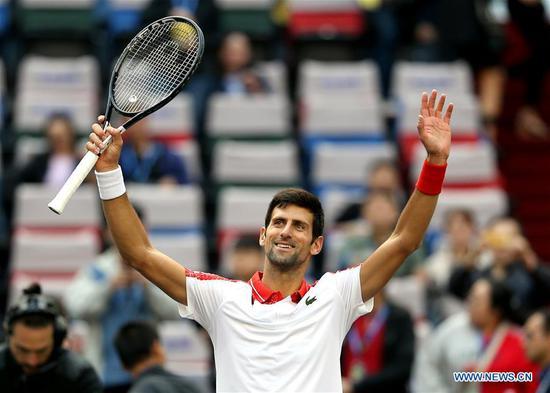 Serbia's Novak Djokovic celebrates after the men's singles third round match against Italy's Marco Cecchinato at the Shanghai Masters tennis tournament on Oct. 11, 2018. Novak Djokovic won 2-0. (Xinhua/Fan Jun)