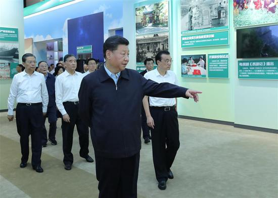 Chinese President Xi Jinping, also general secretary of the Communist Party of China (CPC) Central Committee and chairman of the Central Military Commission, visits an exhibition of achievements in commemoration of the 70th anniversary of the founding of the People's Republic of China (PRC) at the Beijing Exhibition Center in Beijing, capital of China, Sept. 23, 2019. Senior officials Li Keqiang, Wang Yang, Wang Huning, Zhao Leji, Han Zheng and Wang Qishan also visited the exhibition. (Xinhua/Ju Peng)