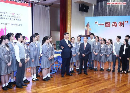 "Chinese President Xi Jinping speaks after watching a Chinese history class themed ""'one country, two systems' and Macao"" at the Premier School Affiliated to Hou Kong Middle School, in south China's Macao, Dec. 19, 2019. (Xinhua/Ju Peng)"