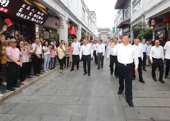 Chinese President Xi Jinping, also general secretary of the Communist Party of China Central Committee and chairman of the Central Military Commission, waves to people while visiting a street lined with ancient memorial archways in Chaozhou, south China's Guangdong Province, Oct. 12, 2020. Xi on Monday arrived in Guangdong to begin an inspection tour of the province. (Xinhua/Wang Ye)