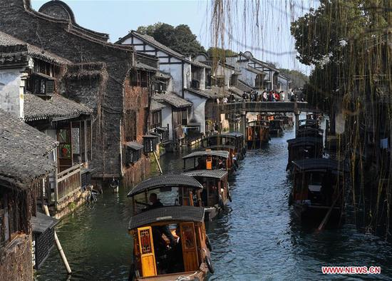 Tourists visit Wuzhen scenic spot in east China's Zhejiang Province, Feb. 6, 2019, the second day of the Chinese Lunar New Year. (Xinhua/Huang Zongzhi)